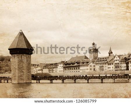 Panoramic view of Chapel Bridge, famous covered wooden bridge. Lucerne Switzerland - vintage style - stock photo