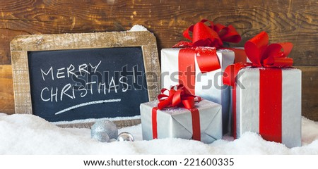 Panoramic view of Christmas gifts and slate. - stock photo