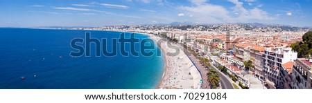 Panoramic view of city of Nice coastline and beach with blue sky and cloudscape background, France. - stock photo