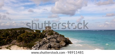 Panoramic view of cliffs with Mayan ruins above the ocean at Tulum, Quintana Roo, Mexico.