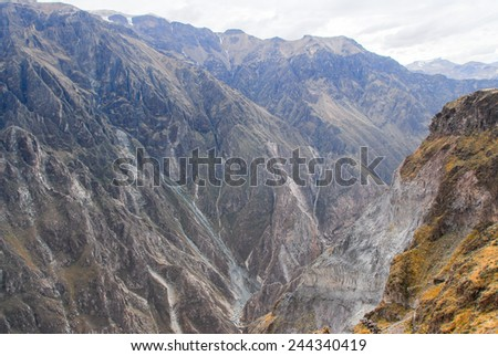 Panoramic view of Colca Canyon, Peru, South America from Mirador Cruz del Condor. One of the deepest canyons in the world. - stock photo