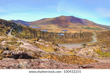 Panoramic view of Conor Pass in the mountains of Dingle, Ireland. - stock photo