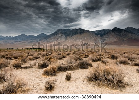 panoramic view of dark clouds in death valley national park, nevada, usa - stock photo