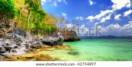 panoramic view of deserted tropical island - stock photo