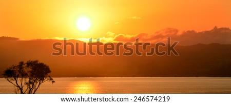 Panoramic view of dramatic  sunrise over lake Rotorua, Bay of plenty, New Zealand. - stock photo