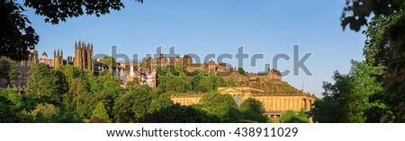Panoramic view of Edinburgh Castle and The Scottish National Gallery above Princes Street Gardens. Scotland, UK - stock photo