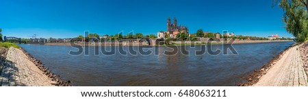 Panoramic view of Elbe, cathedral and old town in Magdeburg, Germany, summer