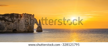 Panoramic view of Etretat Aval cliff at sunset - stock photo