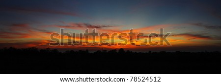 Panoramic view of evening seacoast - stock photo