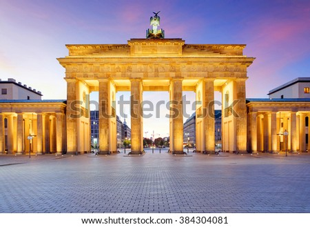 Panoramic view of famous Brandenburger Tor (Brandenburg Gate), one of the best-known landmarks and national symbols of Germany, in beautiful evening light at sunset, Pariser Platz, Berlin, Germany