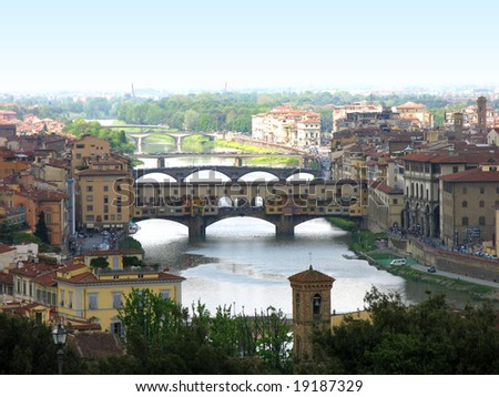 Panoramic view of famous bridge Ponte Vecchio on Arno river in Florence Firenze Tuscany Italy - stock photo
