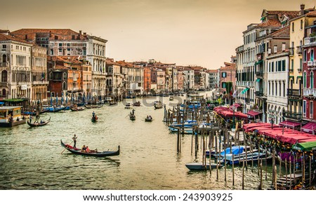 Panoramic view of famous Canal Grande from famous Rialto Bridge at sunset in Venice, Italy with retro vintage Instagram style filter effect - stock photo