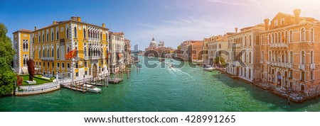 Panoramic view of famous Canal Grande with Basilica di Santa Maria della Salute in beautiful golden evening light on a sunny day, Venice, Italy - stock photo