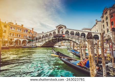 Panoramic view of famous Canal Grande with famous Rialto Bridge at sunset in Venice, Italy with retro vintage Instagram style filter effect - stock photo