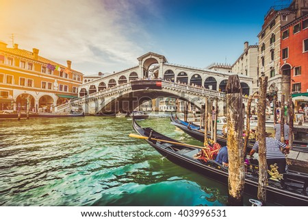 Panoramic view of famous Canal Grande with old Rialto Bridge in beautiful golden evening light at sunset in summer with retro vintage Instagram style pastel tone grunge filter effect, Venice, Italy