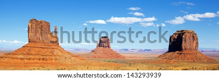 panoramic view of famous Monument Valley with blue sky, USA - stock photo