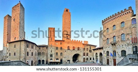 Panoramic view of famous Piazza del Duomo in San Gimignano at sunset, Tuscany, Italy - stock photo