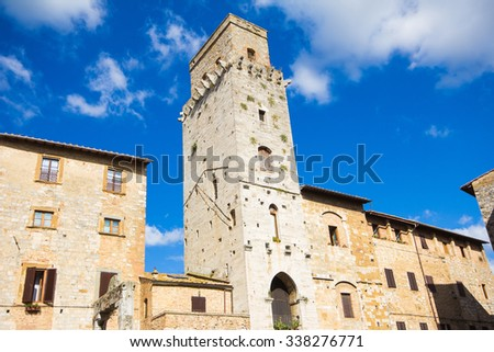 Panoramic view of famous Piazza del Duomo in San Gimignano in Tuscany - Italy. - stock photo
