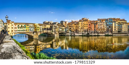 Panoramic view of famous Ponte Vecchio with river Arno at sunset in Florence, Tuscany, Italy - stock photo