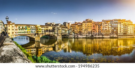 Panoramic view of famous Ponte Vecchio with river Arno at sunset in Florence, Tuscany, Italy with retro vintage Instagram style filter effect - stock photo
