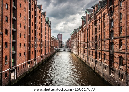 Panoramic view of famous Speicherstadt with dark clouds before the storm in Hamburg, Germany