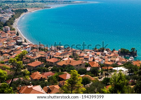 Panoramic view of fishing port in Nafpaktos city in Greece - stock photo