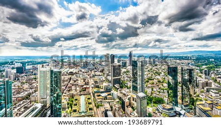 Panoramic view of Frankfurt am Main skyline with dramatic cloudscape, Hessen, Germany - stock photo