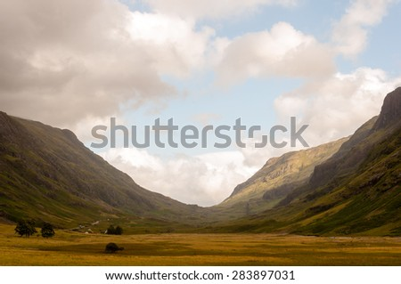 panoramic view of glencoe, scottish highlads on a cloudy day - stock photo