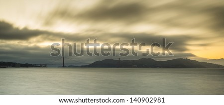 Panoramic view of Golden Gate Bridge in sunset