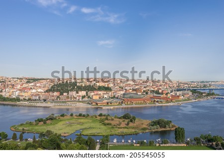 Panoramic view of Golden Horn inlet from Eyup-Pierre Loti Point at sunset, Istanbul, Turkey.  - stock photo