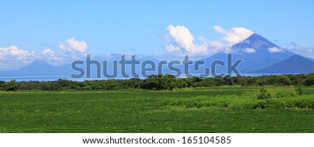 panoramic view of group of volcanoes on the shore of Lake Managua.  - stock photo