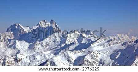 Panoramic view of high mountains. Caucasus, Russia, Mt. Ushba. - stock photo