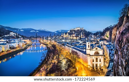 Panoramic view of historic city of Salzburg with Festung Hohensalzburg and river Salzach at blue hour, Salzburger Land, Austria - stock photo