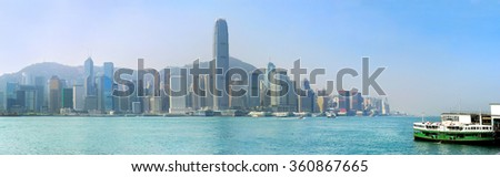 Panoramic view of Hong Kong island with ferry boat from Kowloon island