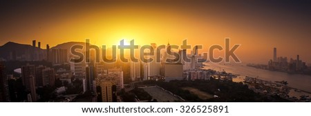 Panoramic view of Hong Kong skyline at sunset - stock photo