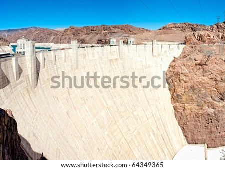 Panoramic view of Hoover Dam and baypass bridge. Hoover Dam, is a popular tourist destination and was once known as Boulder Dam.