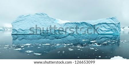 Panoramic view of iceberg, west coast of antarctic peninsula - stock photo
