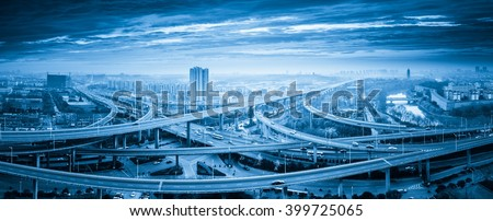 panoramic view of interchange overpass bridge in nanjing, blue tone - stock photo