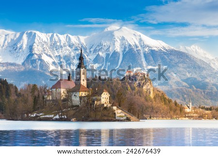 Panoramic view of Julian Alps, Lake Bled with St. Marys Church of the Assumption on the small island. Bled, Slovenia, Europe.  - stock photo