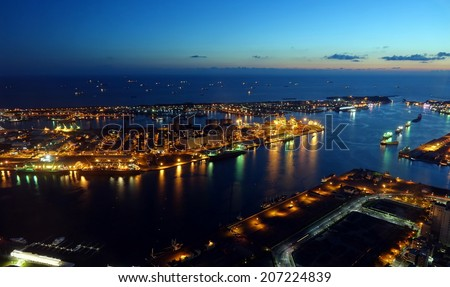 Panoramic view of Kaohsiung Port and Chijin Island at Dusk The letters -KaoPort- stand for Kaohsiung Port. - stock photo