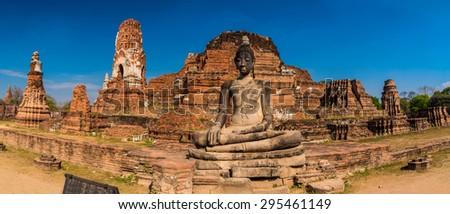 Panoramic view of large seated buddha at Wat Mahathat in Ayuthaya, Thailand - stock photo