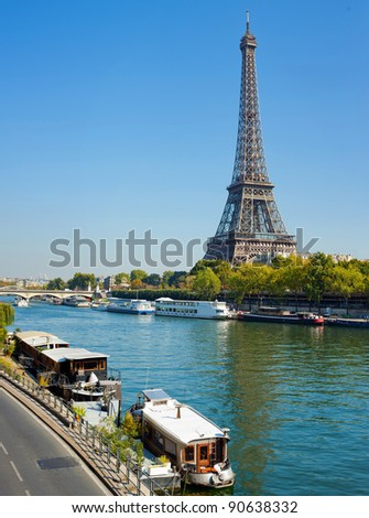 Panoramic view of living barge on the Seine in Paris with Eiffel tower backround. France - stock photo