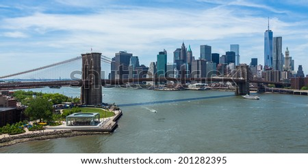 Panoramic view of lower Manhattan and Brooklyn bridge in New York - USA - stock photo