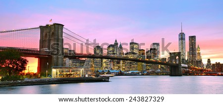Panoramic view of Manhattan and Brooklyn Bridge at dusk. - stock photo