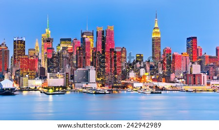 Panoramic view of Manhattan at dusk with red sunlight. - stock photo