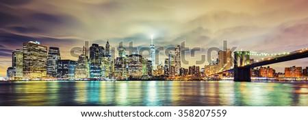 Panoramic view of Manhattan at night, New York City.  - stock photo