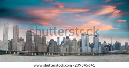 Panoramic view of Manhattan East Side with cloudy sky.