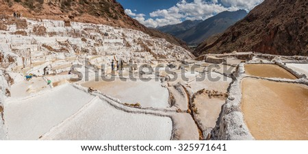 Panoramic view of Maras salt farm, in the sacred valley, Cusco, Peru. - stock photo