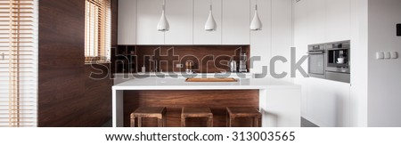 Panoramic view of modern style kitchen island in wood kitchen