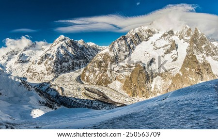 Panoramic view of Mont Blanc (Monte Bianco) mountain massive in Alps, highest point of Europe (4810 m), view from Italian side, from Courmayeur ski resort, Valle d'Aosta province - stock photo